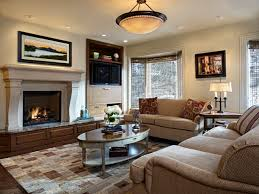 elegant dark wood floor family room photo in denver with beige walls a standard fireplace