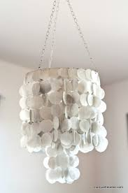 my sister has been eyeing the faux capiz shell chandeliers for a little while now so i thought i d try my hand at one and see if it would work and it did