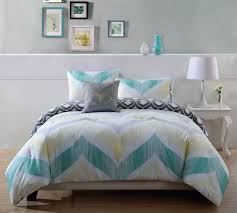 catchy teen bedding ideas features white bed frame with black wooden legs and white blue green gray colors patterned bedding set