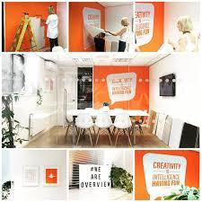 graphic designers office. Orange Office Interior Design. Overview Studios. Vinyl Wall Graphics Graphic Designers