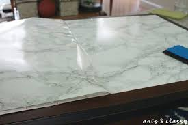 diy faux marble coffee table makeover applying the marble contact paper faux marble coffee table black