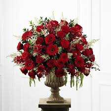 red rose and orchid altar arrangement
