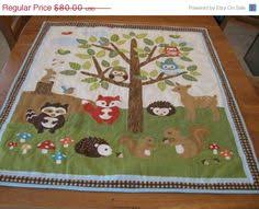 A personal favorite from my Etsy shop https://www.etsy.com/listing ... & Spring Sale Animals in the Forest Crib Quilt for a Baby Boy or Toddler Boy. Adamdwight.com