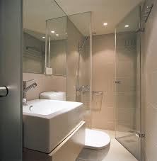 the bathroom door is of a frosted glass design that slides rather than swings open to