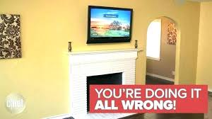 tv mount over fireplace mounted above fireplace wall mount above fireplace why a should never be tv mount over fireplace