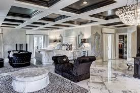 elegant modern bedroom with black and white theme tufted bed coffered ceiling and upholstered