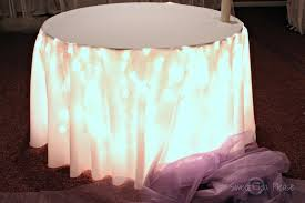 andrea howard blog decorating a cake table with lights and tulle throughout under lighting ideas