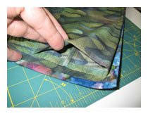Quilt Lessons: How to Make a Sleeve for Wall Hanging Quilts ... & Once the sleeve has been securely stitched to the quilt back, remove the  basting stitch from the sleeve. This tuck allows room for the hanging  device to be ... Adamdwight.com