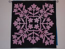 Annette Mahon & In Above the Rainbow, the quilt shop owner makes a quilt called
