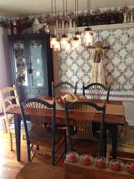 small rustic dining room design with creative diy hanging chandelier lighting above reclaimed wood dining table and burlap table runner also high back