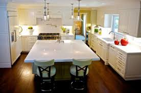 mercury glass pendants make a fine addition to this elegant white kitchen with a touch of