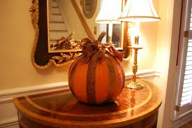 Decoupage a pumpkin with Ribbon for Halloween.