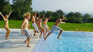 swimming pool with friends. Delighful Swimming Friends Jump Into A Luxurious Backyard Swimming Pool Stock Video Footage   Videoblocks With Swimming Pool E