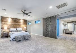 Contemporary master bedroom with distressed wood sliding barn door