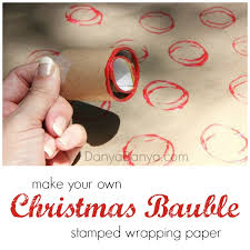 make your own bauble stamped wrapping paper with a diy toilet paper roll stamper