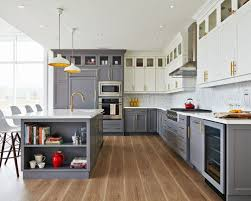 Example of a transitional l-shaped kitchen design in Toronto with gray  cabinets, an