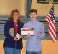 st veronica students win knights of columbus essay contest joanne nelson language arts teacher and luke valencia 2nd place winner photo courtesy of st veronica s