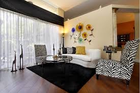 Black and white chairs living room Contemporary Living Small Living Room With Zebra Print Armless Chairs One Small White Sofa Glass Furniture Ideas 17 Zebra Living Room Decor Ideas pictures