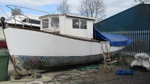 27 wooden ex naval boat for