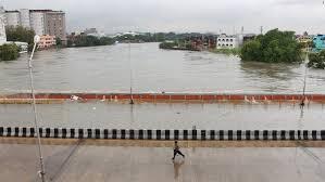 chennai floods a climate change wake up call for world cnn a man runs through a bridge across an over flowing adyar river in chennai