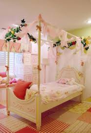 kitty otoole elegant whimsical bedroom: bedroom whimsical bedroom design ideas feature white wooden stained canopy bed and soft pink canopy