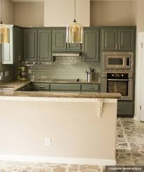 green painted kitchen cabinets with teal backsplash