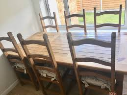 beautiful solid oak farmhouse dining table with 6 chairs and hand made duck filled seat cushions