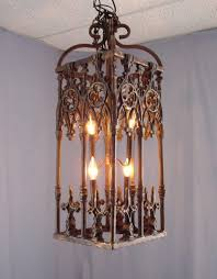 furniture 30 wrought iron old english real candle chandelier garden throughout flameless candle chandelier plan