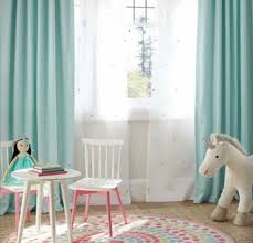 colorful baby nursery ideas with soft green curtain and white sheer using pink braided rug