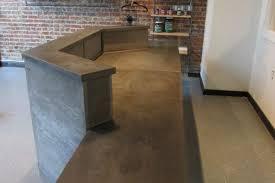 Concrete reception desk concrete work surfaces with woodform veneer