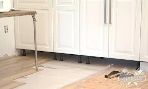 laminate flooring under kitchen cabinets installing laminate flooring around kitchen cabinets do you lay laminate flooring