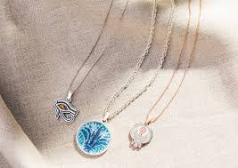 pendants pearls tassels or beads wver style tickles your collarbone necklaces of all varieties can trace their origins to the caves of the stone