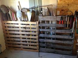 pallet in the garage to tidy away brooms rakes shovels and outdoor broom storage cupboard