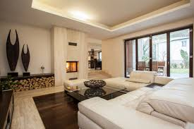 elegant living room contemporary living room. elegant contemporary living room with dark hard wood floor overstuffed white furniture and