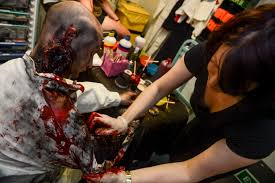 file jenny bucklant right a makeup artist with utees in action applies makeup and a prosthetic leg to pet thomas an actor with utees in action
