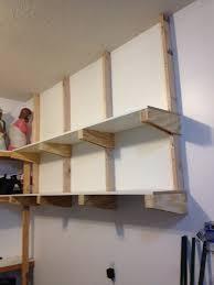 overhead garage shelving plans build diy garage floating shelf diy cost of building a wood fence