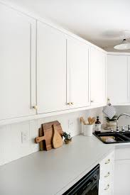 paint and plywood trim transform outdated kitchen cabinets budget friendly kitchen update cabinets