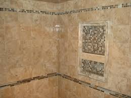 i like the stone tile with glass tile accents  niche also want a