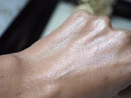 makeup revolution liquid starlight highlighter hand swatch blended