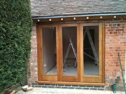 oak triple bifold doors