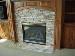 indoor stone fireplace. fascinating home decorating design with cream stone indoor fireplace design, rectangular black iron insert and light brown solid wood