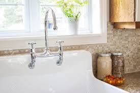 White Kitchen Sink Faucets Rustic White Porcelain Kitchen Sink With Curved Faucet And Tile