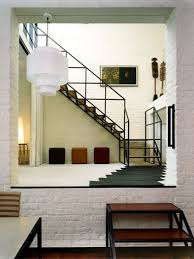 Contemporary wooden l-shaped open and metal railing staircase idea in Other