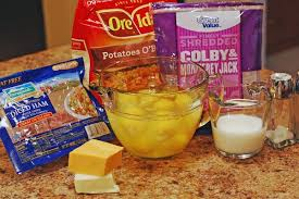 crockpot breakfast cerole cooking spray to oil the crock 28 oz bag frozen o brien potatoes 1 2 lb diced ham 8 oz shredded cheese i used cheddar and