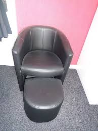 black faux leather tub chair with foot stool