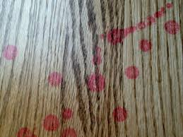 red wax stains on wood floor