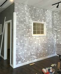 Use venetian plaster to add texture to your faux brick wall, but don't