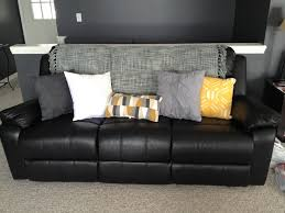Impressive Black Leather Couch Up A With Bright Pillows Throughout Inspiration Decorating