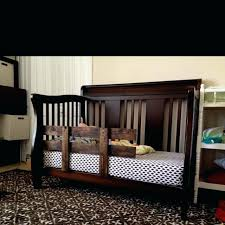 toddler bed with rails toddler bed rail made from palette sanded and stained has l brackets toddler bed with rails