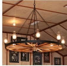 wagon wheel chandelier with downlights chandelier april
